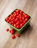 Grape tomatoes in ceramic container