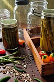 Asparagus, beans and peppers with pickling spices and antique preserving jars