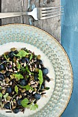 Wild rice salad with grains, blueberries and herbs (Quebec)