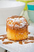 A mini sponge cake with caramel sauce