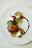 A salad with goat's cheese, beetroot, fresh figs and balsamic vinegar