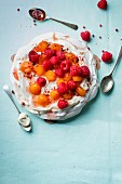 Pavlova with watermelon poached in rosé wine with raspberries, pink pepper and vanilla yoghurt