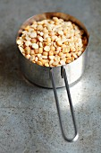 Dried yellow peas in a saucepan