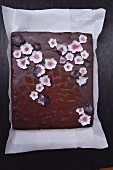 Chocolate cake decorated with sugar flowers