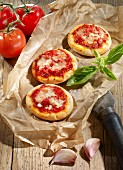 Mini pizzas with tomato sauce and cheese