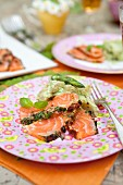 Marinated salmon with potato salad and green asparagus