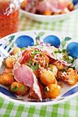 Gnocchi with tomato sauce, ham, Parmesan cheese and fresh basil