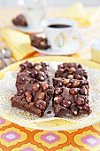 Slices of chocolate tray bake cake with hazelnuts