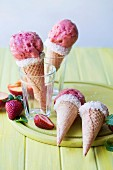 Peach and strawberry frozen yoghurt in chocolate-coconut cones
