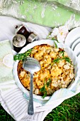Cauliflower crumble with bacon and cheese for a picnic in a field