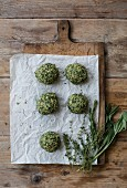 Spinach dumplings on a chopping board