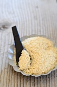 A bowl of oats with a spoon