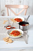 Pasta all'amatriciana (pasta, sieved tomatoes, bacon, garlic and Pecorino cheese)