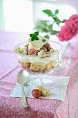 A trifle with red gooseberries and homemade almond biscuits