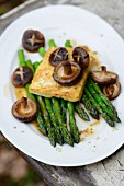 Teriyaki tofu with green asparagus and shiitake mushrooms