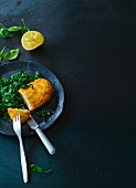 Turkey escalope in a coconut coating on spinach (Paleo)