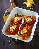 Peppers filled with lentils on baked potatoes
