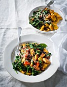 Pumpkin and sage gnocchi with baby spinach, pumpkin seeds and dried tomatoes