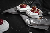 Raspberry meringue nests with sweet meal worms