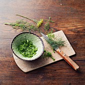 Aromatic herb mixture à la Hildegard von Bingen being made