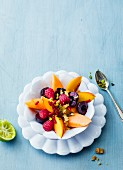 Fruit salad with walnuts, pistachios and goji berries