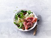 Fennel and lettuce with smoked ham and dried tomatoes