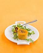 Spicy pumpkin tartlet on an orange surface