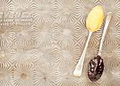 Lemon curd and cherry jam on spoons