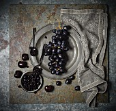 An arrangement of grapes, black cherries and cherry jam