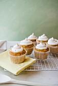 Lemon meringue cupcakes on a cooling rack