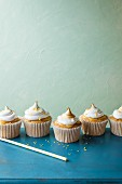 Lemon meringue cupcakes on a blue table