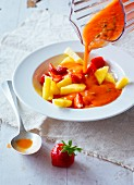 Summer minestrone, pineapple and strawberries with cold tomato sauce