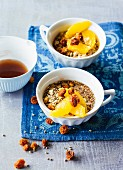 Oat and hemp muesli with oranges and dried physalis