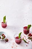 Strawberry and pomegranate smoothies with beetroot, goji berries and figs