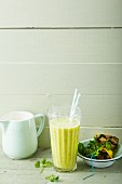 A pineapple and peach smoothie with coriander and coconut oil