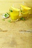 Mango and coconut smoothies with coriander and turmeric