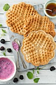 Vegan gluten-free waffles with blackberry yoghurt