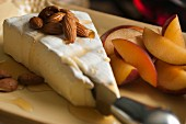 Brie with almonds, honey and red plums