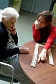 Alzheimer's patient plays dominoes