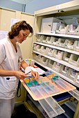 Pharmacist dispensing drugs