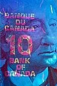 Canadian banknote in UV light
