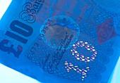 Ten pound banknote in UV light