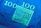 Dominican Republic banknote in UV light
