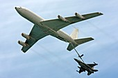 F16 jet being refueled by a Boeing 707
