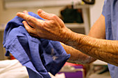 Surgeon drying hands after scrubbing
