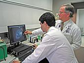 Oncologic surgeons reviewing an MRI
