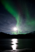 Aurora borealis and Moon