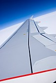 Aircraft wing and blue sky