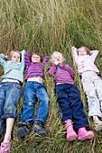 Girls lying in a meadow
