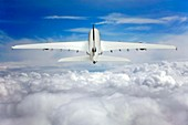 Aeroplane ascending above clouds